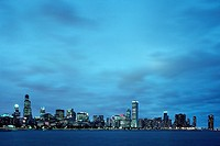 The Chicago skyline on Lake Michigan at dusk.