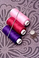 colored thread for sewing with needle and thimble