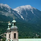The bell towers of Dorn zu St Jakob Cathedral in Innsbruck, Austria, with the Karwendal Mountains in the background.