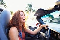 Carefree Woman Driving Convertible