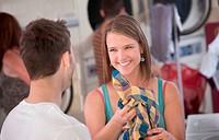 Flirting Woman in Laundromat