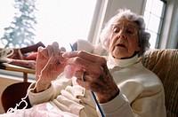 Elderly woman knitting