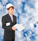 Engineer _ builder on background of cloudy sky