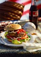 A hamburger and a bottle of coke