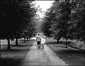 Man Walking With Dog Down Rural Path, Cullman County, Alabama, USA