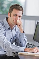 Portrait of young man working in office