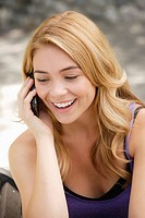 Portrait of young woman talking on phone
