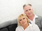 Germany, Hamburg, Couple on sofa, portrait