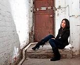 Girl sitting in basement