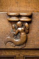 Chorgesthl, Drolerien an den Gesthlwangen mit sprichwrtlichen Darstellungen, 1493 von Johannes Gruter aus Wesel, Meerjungfrau mit Kamm und Spiegel