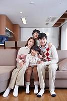 Happy family on the sofa
