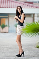 Attractive young woman is standing in the street