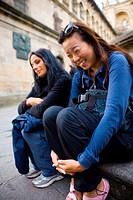 Friends having fun and laughing at Santiago de Compostela cathedral Coruña, Galicia, Spain. Pilgrims goal at the Camino de Santiago pilgrimage way.