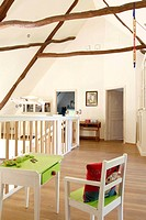 Childrens chair and table on upper floor