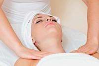 Closeup of human hands massaging a young beautiful woman