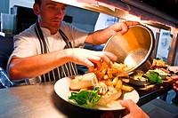 Chef with dish in restaurant kitchen