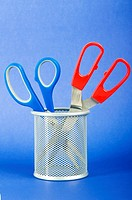 Colorful scissors on the color paper background