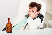 Guy is suffering from hangover because beer is gone
