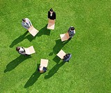Business people in outdoor meeting standing in circle