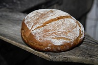 Germany, Upper Bavaria, Egling, Bread in wood stove bakery, close up