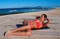 woman does doing sports on a platform at the sea _ supine position