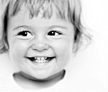black _ White colour _ portrait of small Pre_Teen girl with dark eyes _ shows their Baby teeth during the laughter