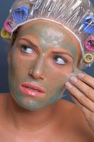 Young woman removes the face mask