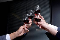 A group of business people are toasting