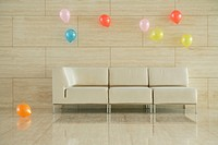 Some balloons and a sofa in a room