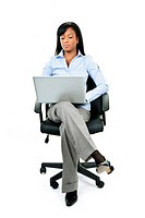 Woman sitting in office chair with computer