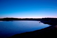 the scenery of the river near grassland before sunrise
