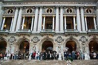 Detail of the main facade of the Paris Opera, officially the National Music Academy, on a rainy summer day.