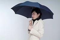 a businesswoman holding a umbrella