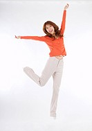 A young lady is jumping and cheering
