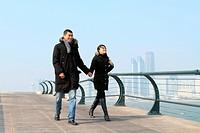 lovers walking hand in hand
