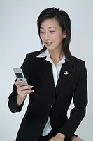 a businesswoman sitting and sending messages