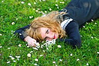 Girl lie on the grass