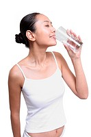 Young woman drinking glass of water