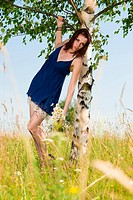 beautiful woman at the birch. Summer meadow