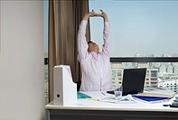 A man gives a stretch in the office