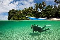 Scuba Diver in Lagoon of Ahe Island, Cenderawasih Bay, West Papua, Indonesia