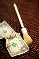Clean black money, dollar note and brush