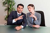 Good looking business people negotiating in a meeting room