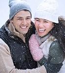 Couple wearing warm clothing smiling