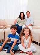 Cheerful family sitting in the living room