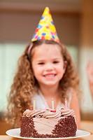 Slice of cake in front of little girl