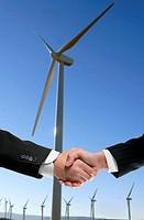 Businessmen environmental wind mill handshake