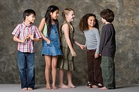 Children 6_7, 8_9 playing together, studio shot