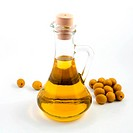An image of green olives and bottle of oil