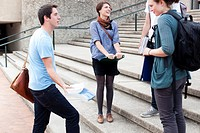 Students talking on campus steps